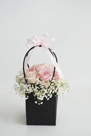 Pink Roses in Paper Bag