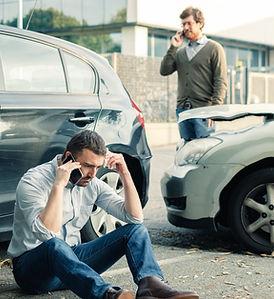 Two men calling car help assistance afte