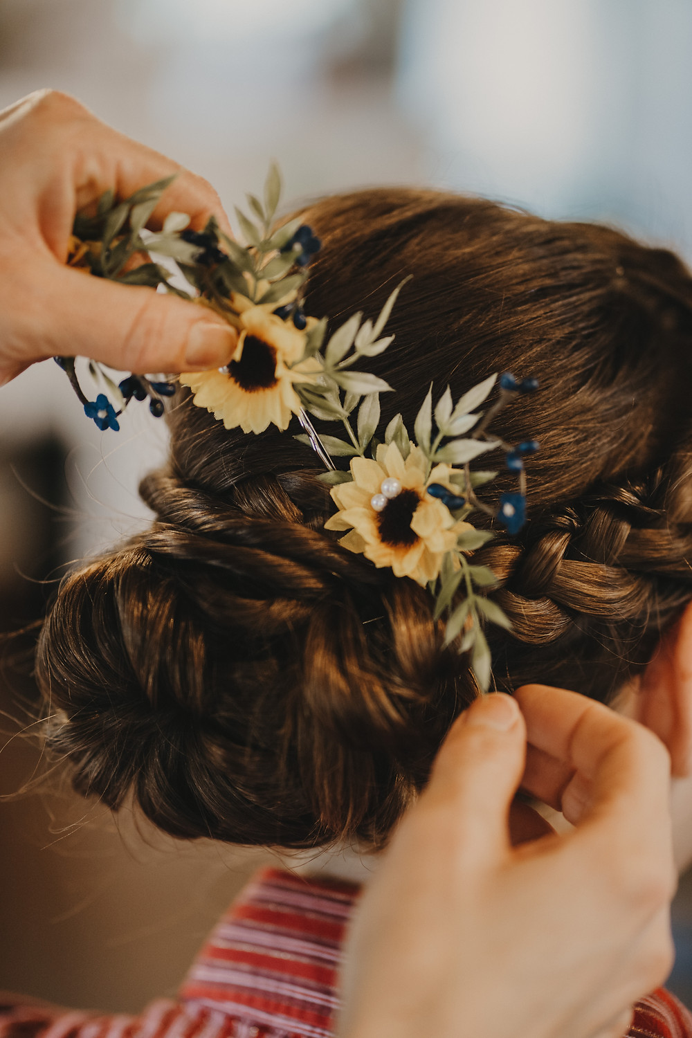 wedding hair stylist adds sunflowers to bride's updo