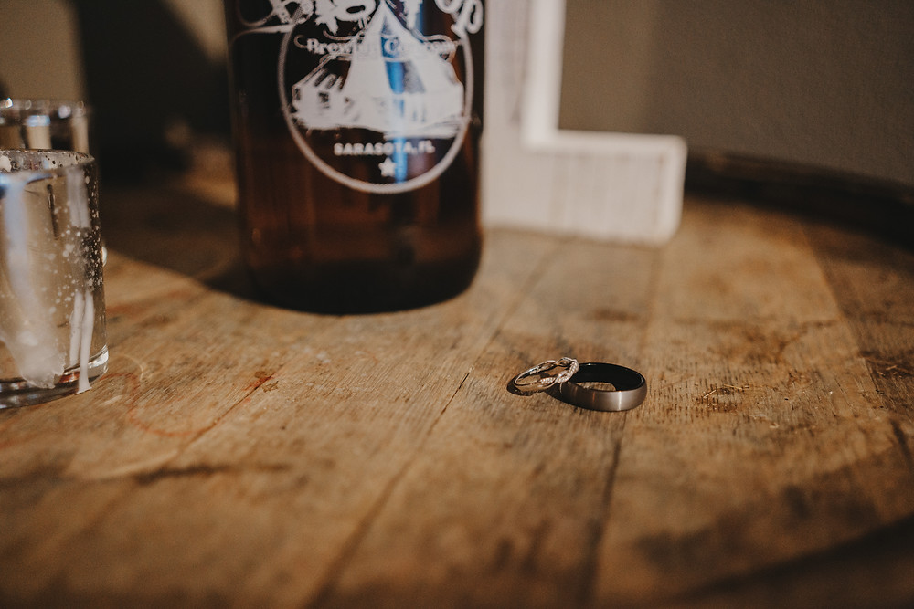 Wedding band details with Big Top growler