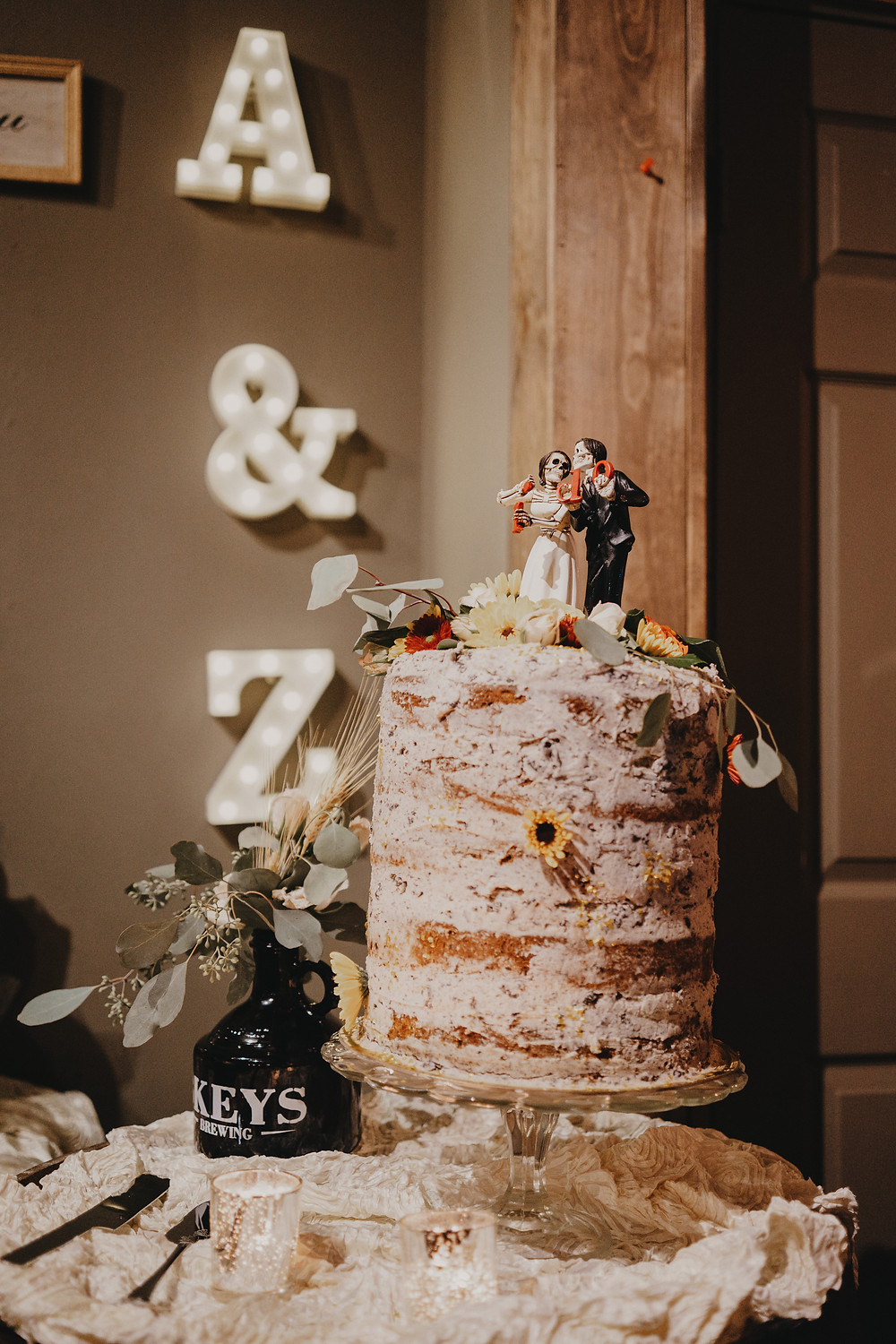 "naked wedding cake and skeleton ""I do"" topper"