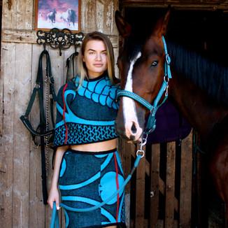 Textile: 60% wool 40% dralon acrylic Product: Cape & skirt