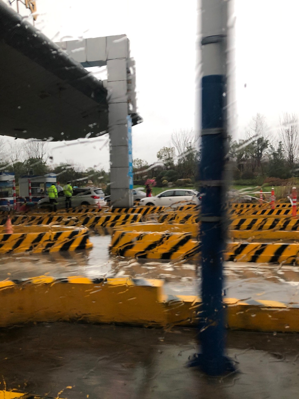 Drivers being check for temperatures at a toll both on the way into Hangzhou from Shanghai