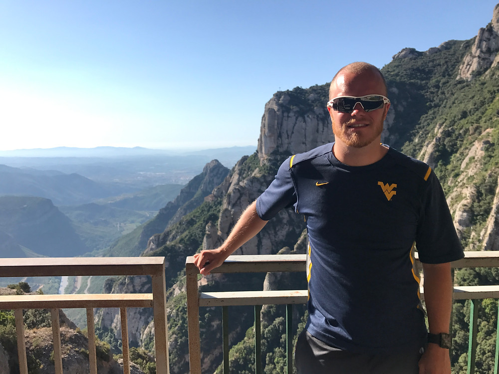 Posing with the picturesque mountains at the Santa Maria de Montserrat Abbey in the Montserrat mountains one hour outside Barcelona, Spain in 2017