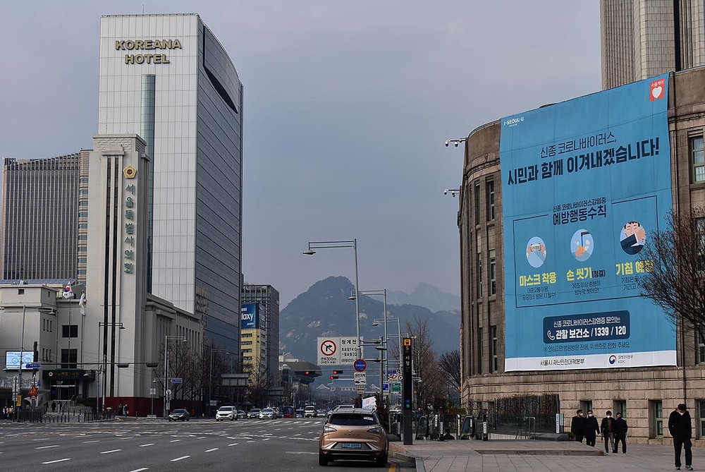 City Hall in Seoul displays a huge banner displaying ways to prevent the spread of COVID-19