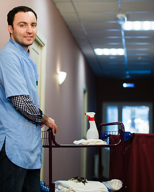 a-man-who-is-on-the-hotel-cleaning-crew-