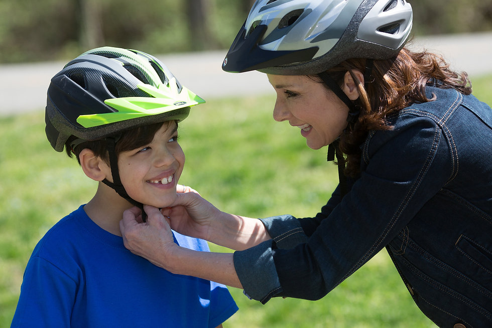 mom putting helmet on son.jpg
