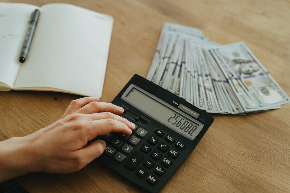 using a calculator and money