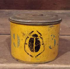 Tin cup in mustard dated 1933