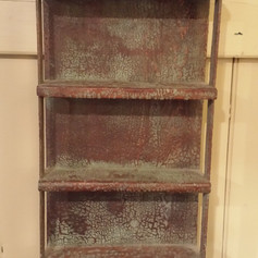 Little hanging shelf in crusty blue over red