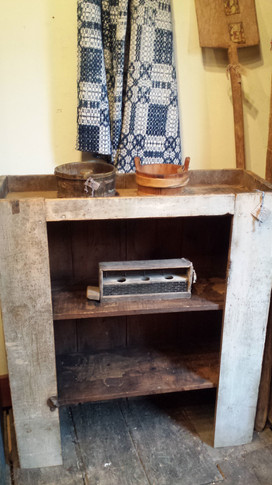 Open cupboard in old putty