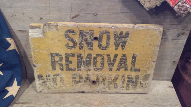 Wood snow removal sign