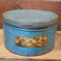 Tin in old blue with label
