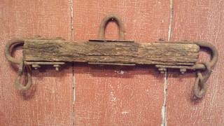 Early iron and wood cattle yoke evener.