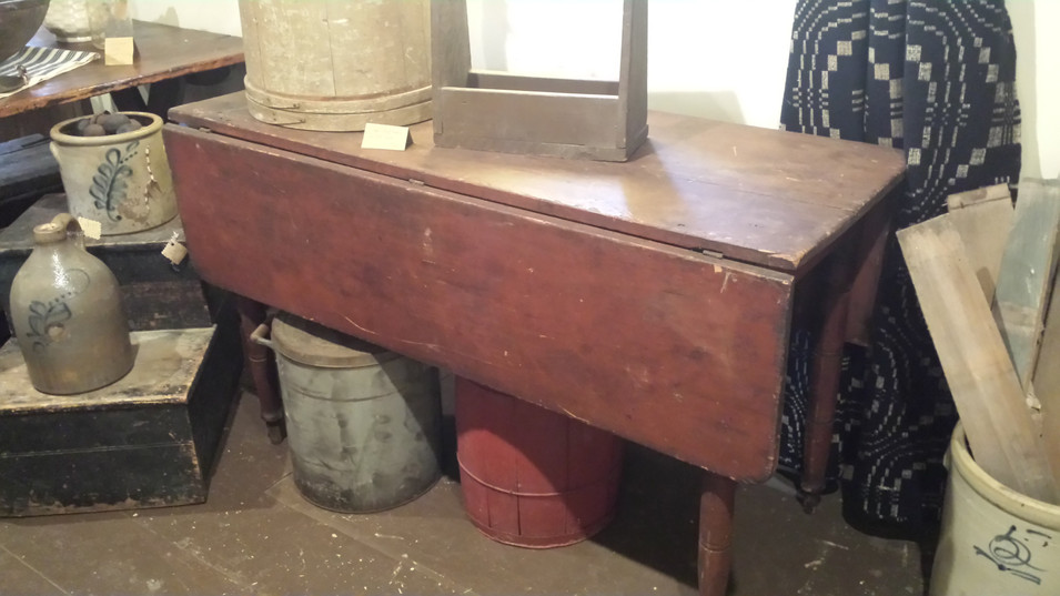 Country drop leaf table in old red