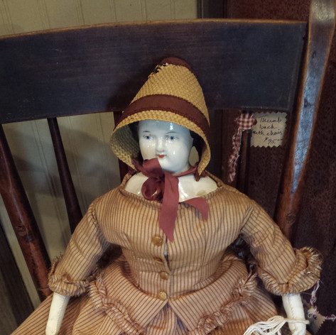 Antique doll with porcelain head