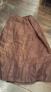 Early brown skirt with blue lining.
