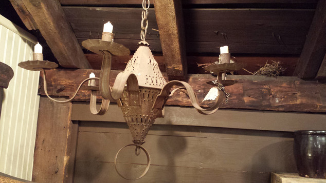 Rusty punched tin chandelier