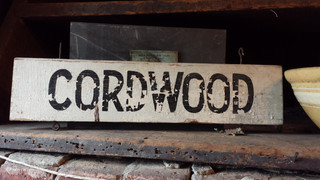 Chippy white and black wood sign