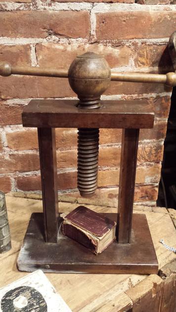 Wood press, neat.