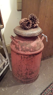 Worn milk can in old red