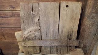 Small primitive barn door with iron hinge
