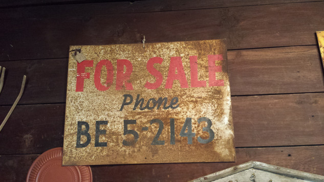 Rusty tin For Sale sign