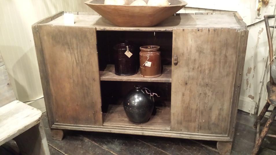 Early open bottom cupboard