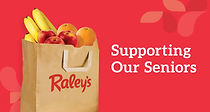 Raley's paper grocery bag filled with food items