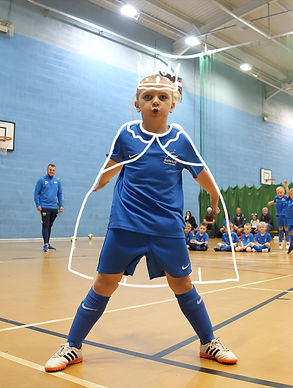 child in a football kit with a animated crown and cape