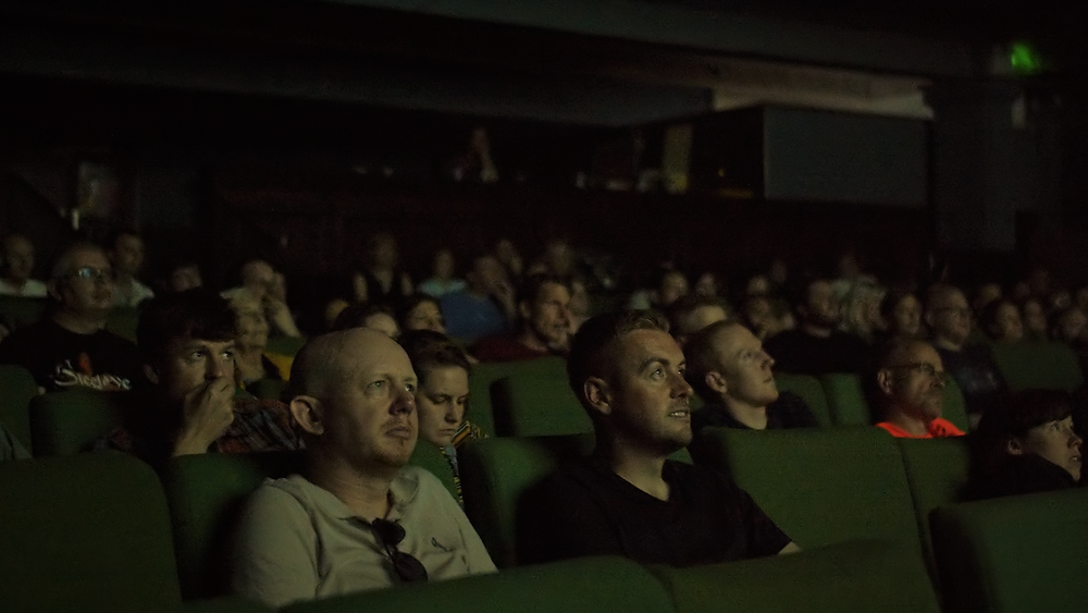 crowd sat in seats watching the spirit of independence micro-budget film festival festival
