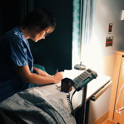 Midwife Alix charting in the wee hours o