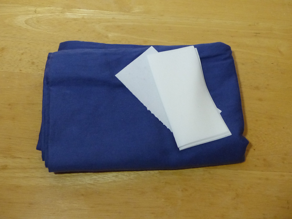Blue pillow case with strips of Tru Earth liquidless laundry detergent