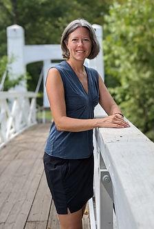 Katie Dunbar owner of Harmonious Renewal standing on bridge in Perkasie, PA