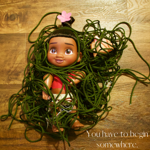 Doll all wrapped up in tangled cords. Caption says: you have to begin somewhere.