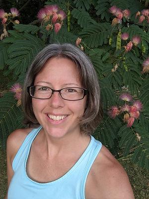 Katie Dunbar owner of Harmonious Renewal in a garden