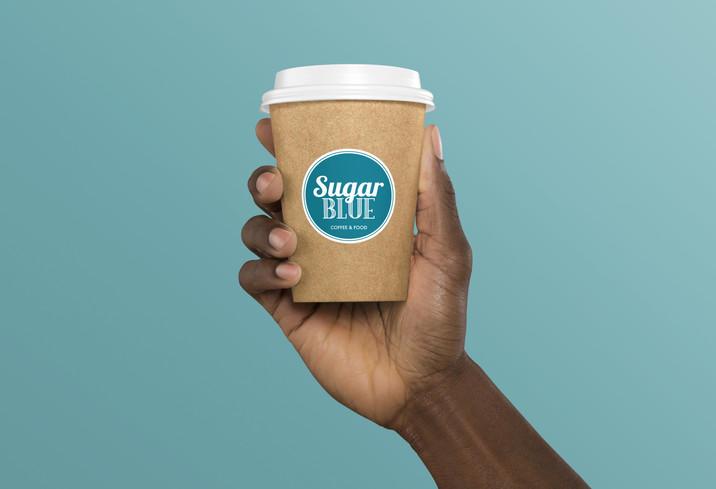 Hand Holding Coffee Cup Mockup.jpg