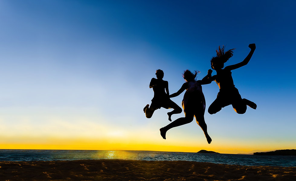 silhouette of friends jumping in sunset.jpg
