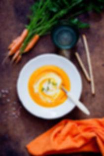 Carrot Soup on dark wooden background.jp