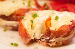 baked proscuitto egg cups with tomato, a