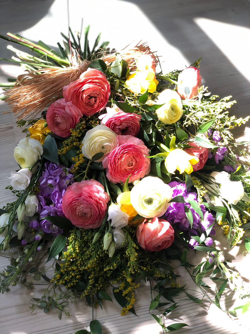 Hand tied funeral sheaf with British spring flowers