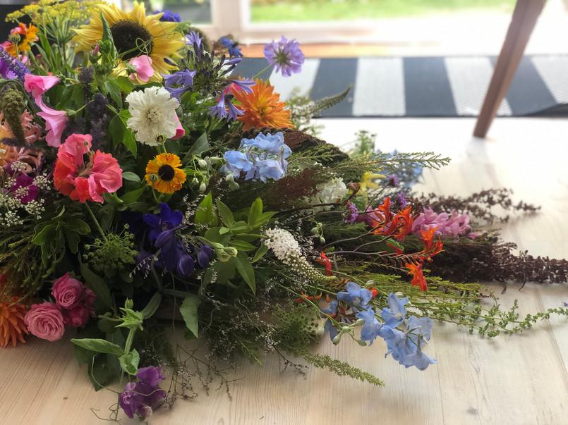 Foam free bright country garden casket arrangement