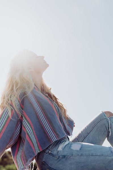 Blonde singer-songwriter Jemima on an Australian beach in the sunshine