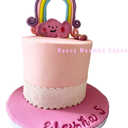 Girls cake with rainbow topper