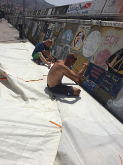 Working on Yalla's mainsail