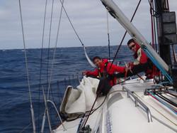 Bringing down the sail at the bow