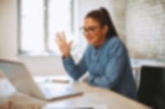 Young woman having video call via laptop