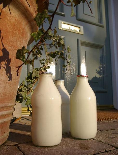three-pints-of-milk-on-a-doorstep-152180