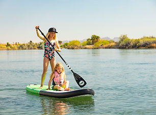Little girls on a paddleboard