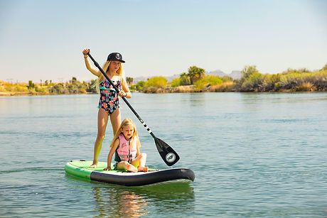 Two little girls on a paddle board